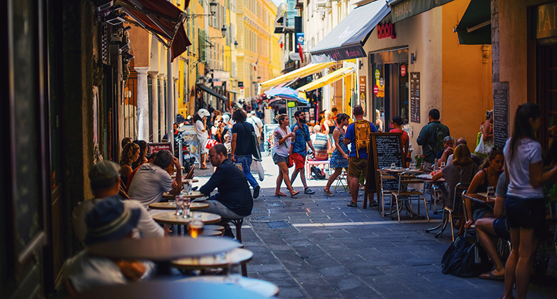 Street lined with shops and cafes in Nice, France.