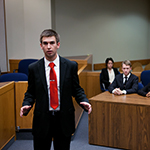 Students hold a mock trial.