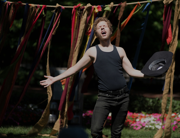 A man singing at shakespeare festival.
