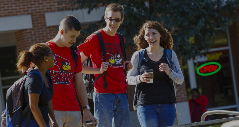 Students laughing as they walk to class.