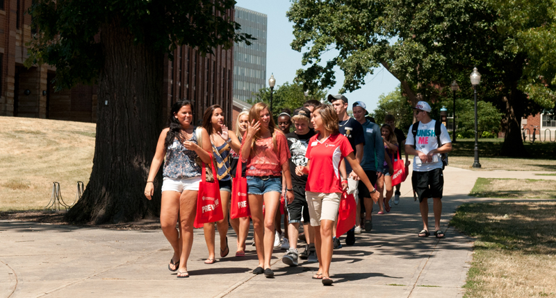 ISU student leads a group of parents and students around campus.
